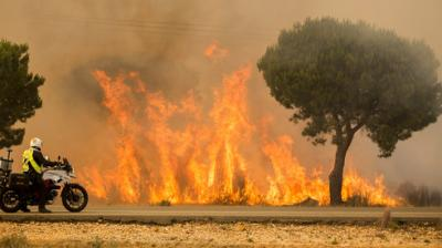 A huge forest fire in southern Spain on Saturday night forced the evacuation many people, a government official said. He said 2,100 had to be evacuated over the weekend, many from campsites and houses near the towns Moguer and Mazagon, but that more than half had been able to return by Monday. (Photo: AP)