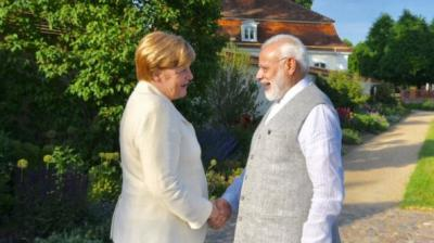 Prime Minister Narendra Modi began his four-nation tour on Monday, aimed at boosting bilateral and economic ties with Germany, Spain, Russia and France. He spoke to German Chancellor Angela Merkel, and will meet German President Frank-Walter Steinmeier. (Photo: Twitter)
