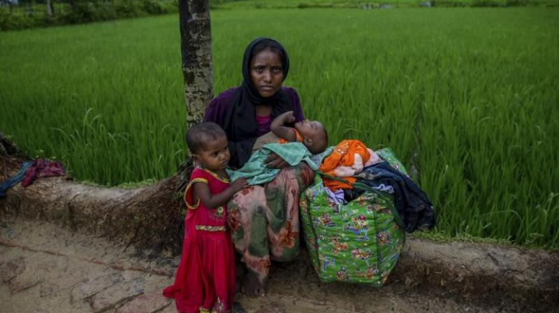 Sacks on stick symbolize plight of displaced Rohingya Muslims