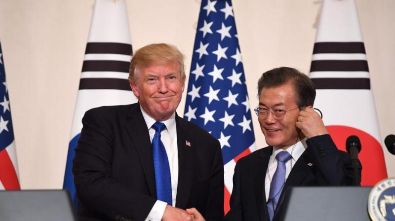 US President Donald Trump (L) shakes hands with South Korea's President Moon Jae-In during a joint press conference at the presidential Blue House in Seoul on Tuesday. (Photo: AFP)