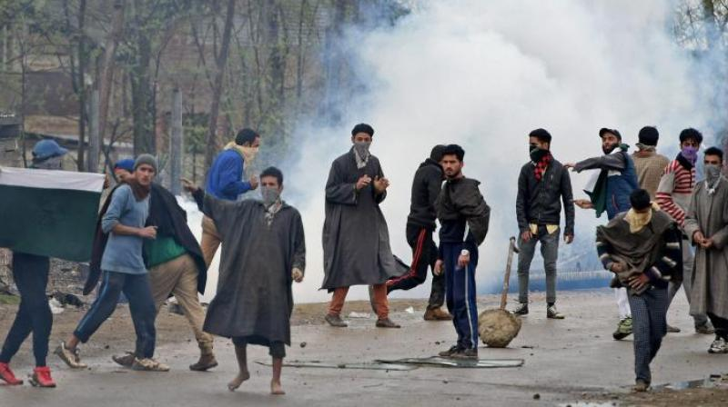 A group of youth pelting stones on security forces during an anti-militant operation at village Durbugh in Chadoora area of central Kashmir's Budgam district. (Photo: PTI)