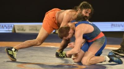 Yoga guru Baba Ramdev on Wednesday showed his wrestling prowess as he defeated 2008 Beijing Olympic silver medalist Andrey Stadnik in a promotional bout of the 2017 Pro Wrestling League (PWL) in New Delhi.