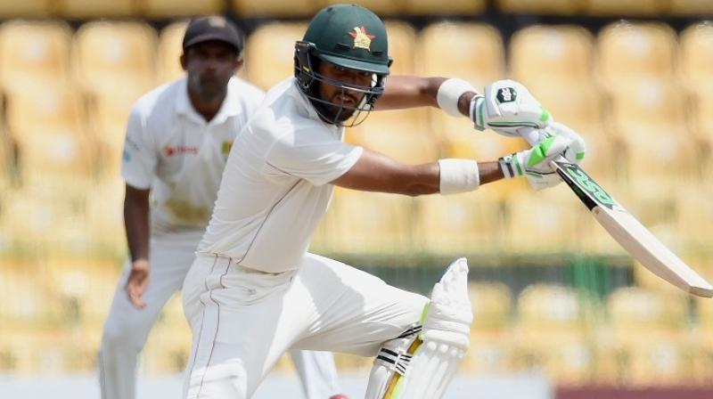 Sikandar Raza's first test century helped Zimbabwe to 377 in their second innings after the touring side had resumed the fourth day on 252-6.(Photo: AFP)