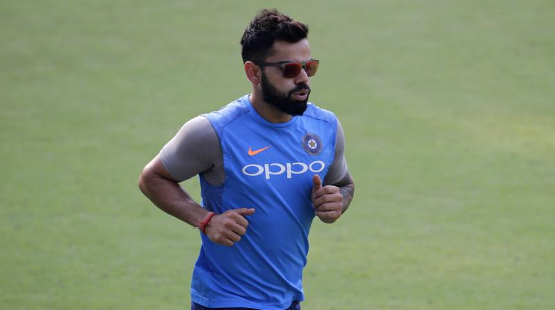Virat Kohli ensured that the TV crew member got proper treatment before he resumed his practice. (Photo: AP)