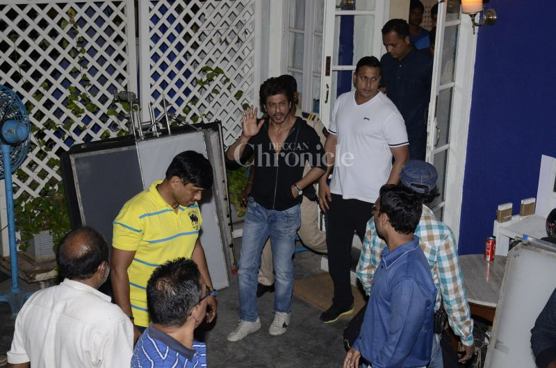 Dressed in a black sipper and blue denim jeans, Shah Rukh Khan was dressed casually as he stepped out of the studio.