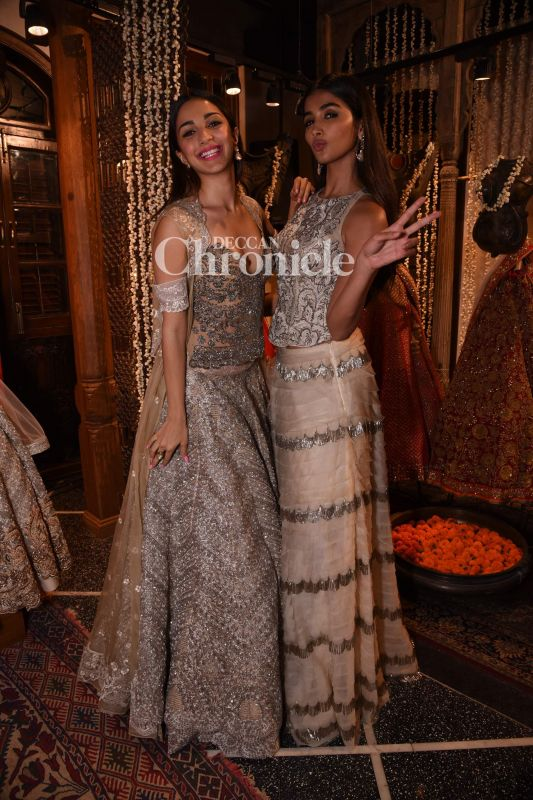 Kiara Advani and Pooja Hegde looked beautiful as they posed together in style at a store launch.