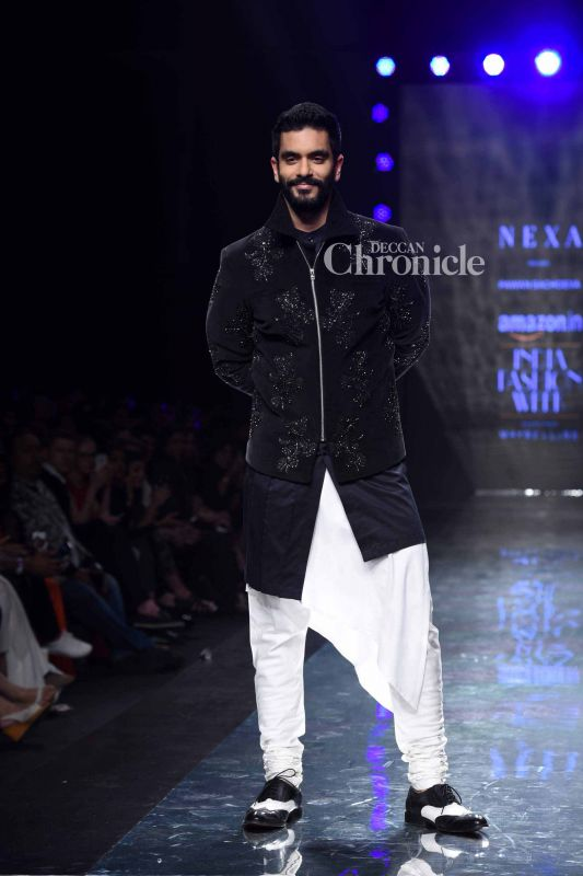 Angad Bedi was his confident best while walking the ramp.