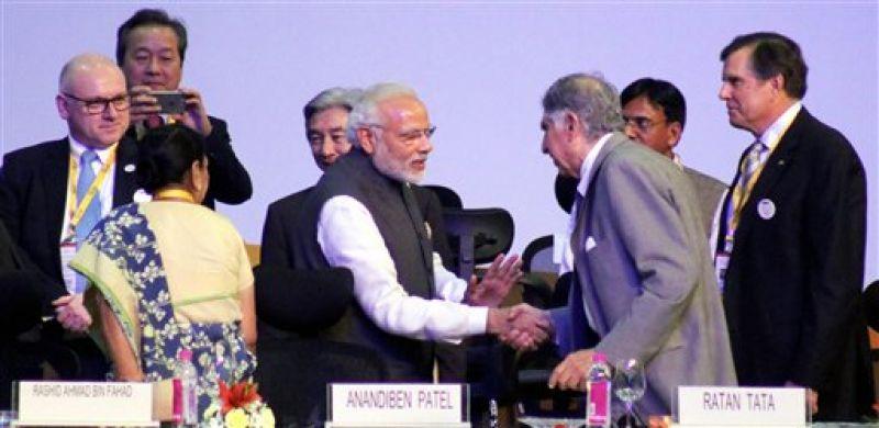 Gandhinagar: Prime Minister Narendra Modi shakes hands with Tata group Interim Chairman Ratan Tata during the Vibrant Gujarat Global Summit 2017 in Gandhinagar, Gujarat on Tuesday. (Photo: PTI)