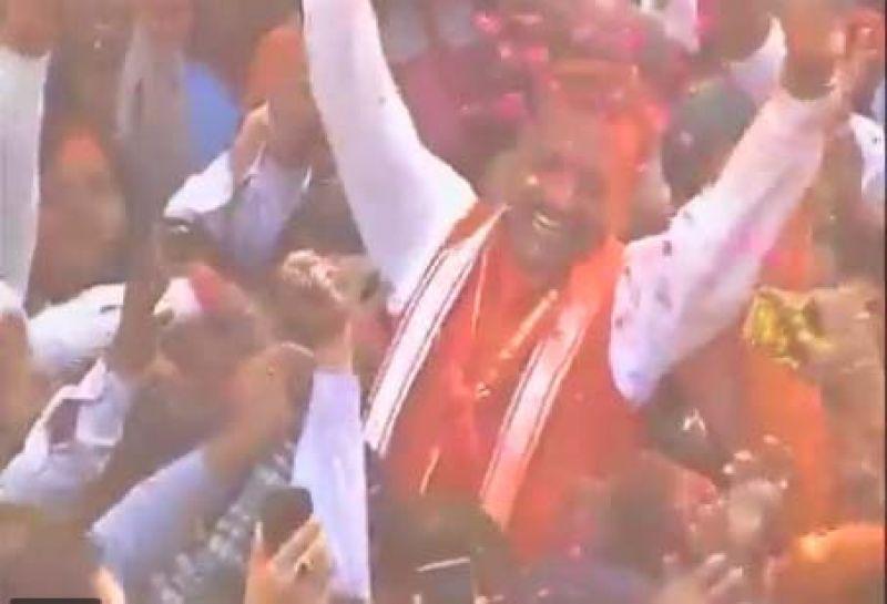 BJP UP state president Keshav Prasad Maurya celebrates in Lucknow as BJP leading in Uttar Pradesh.