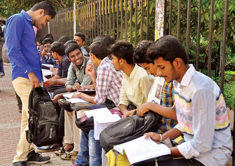 Last minute preparations by students of a PU College in Sheshadripuram. (Photo: DC)