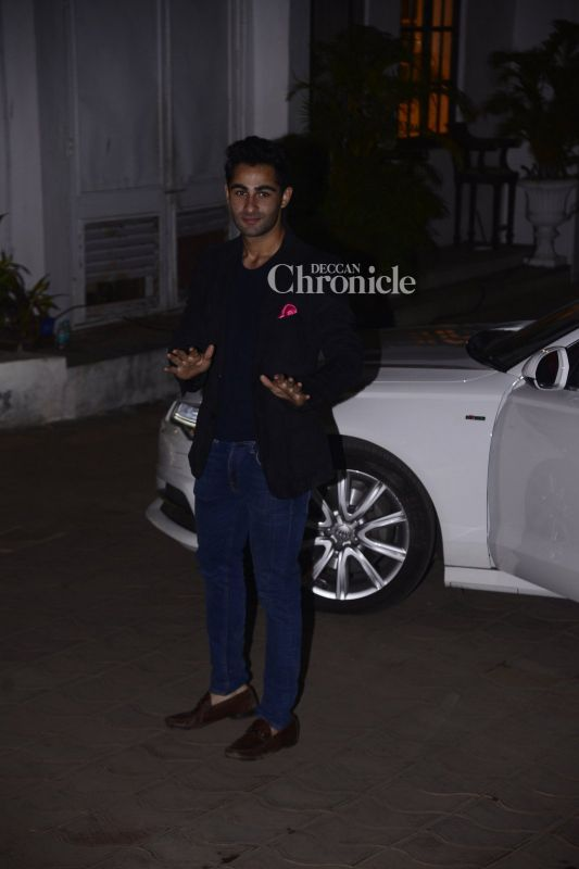 Armaan Jain acknowledges the cameras.