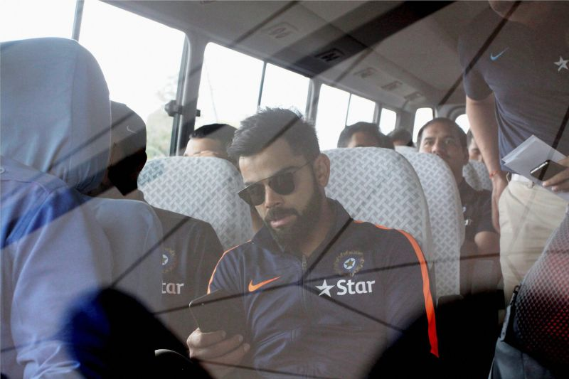 Virat Kohli snapped sitting inside the team bus, as Team India wait to be taken to their hotel from the airport. (Photo: PTI)