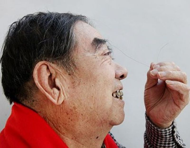 Talking of weird records, 81-year-old Zheng Shusen from China made news for the longest eyebrow hair measuring 7.5 inches. He also said that sometimes the hair comes in his mouth while eating and he tucks it behind his right ear to prevent that (Photo: Guinness World Records)