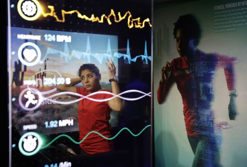 A model demonstrates a New Balance RunIQ smart watch at the Intel booth during CES International, Friday, Jan. 6, 2017, in Las Vegas. (AP Photo/John Locher)