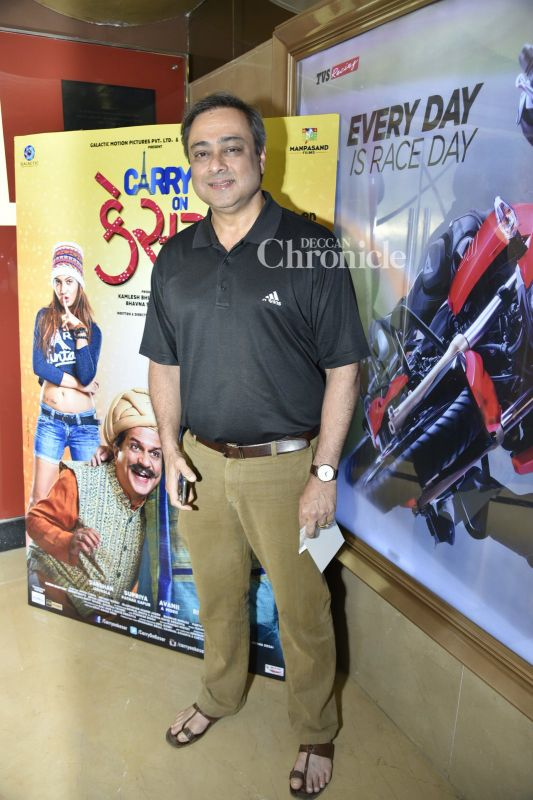 Sachin Khedekar smiles for the cameras at the event.