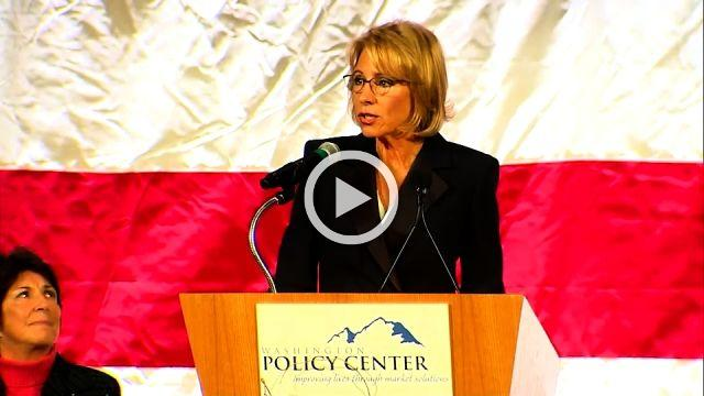 Hundreds protest as DeVos calls for change in public education