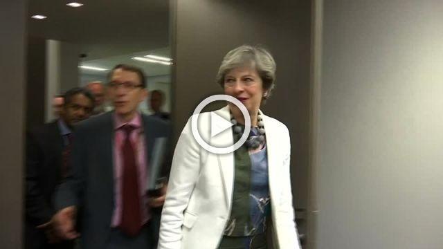 No trade talks but UK's May wins gesture at summit