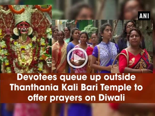 Devotees queue up outside Thanthania Kali Bari Temple to offer prayers on Diwali