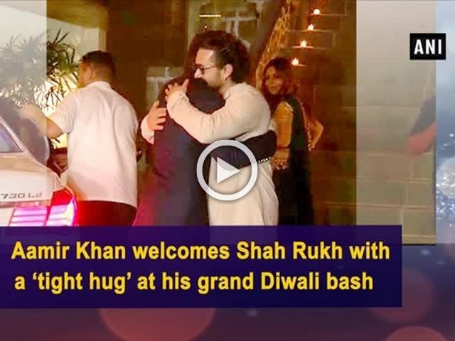 Aamir Khan welcomes Shah Rukh with a 'tight hug' at his grand Diwali bash