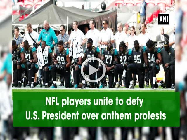 NFL players unite to defy U.S. President over anthem protests