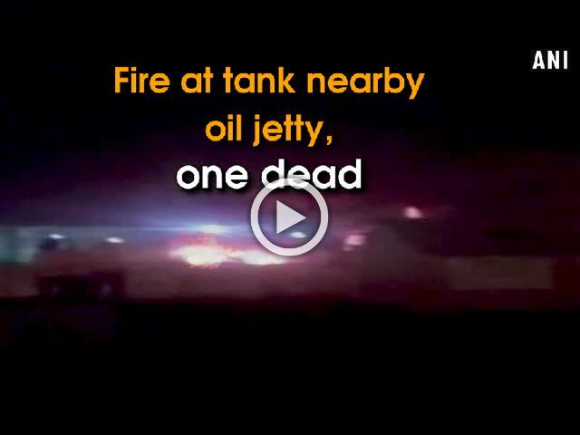 Fire at tank nearby oil jetty, one dead